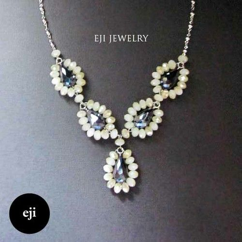 EJI JEWELRY - Bella Necklace - Black and White Crystals Necklace by Eji Jewelry #statementnecklace #jewelry #fashion #jewelrystore #designer #handmadejewelry #accessories #crystals #crystalstones #gemstones #white #black #vintage #necklace #classy #stylish #bridal #partyjewelry #womanjewelry #beautiful