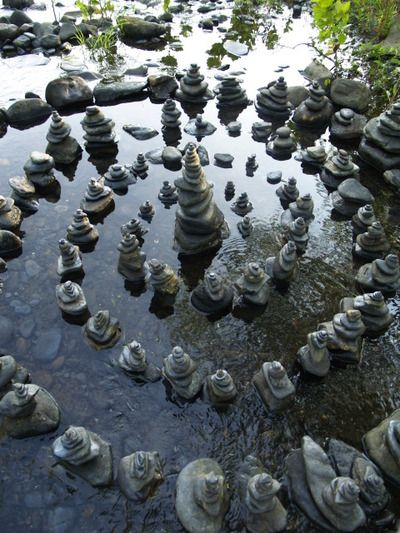 a spiral of cairns in the water