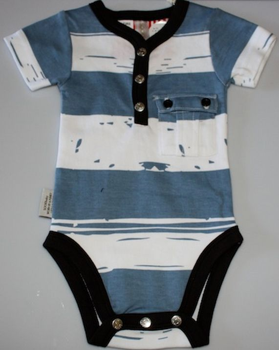 How handsome will your little boy look in this outfit! Blue and white patterned playsuit with black trim. Front pocket for treasures! 100% cotton. Machine washable.