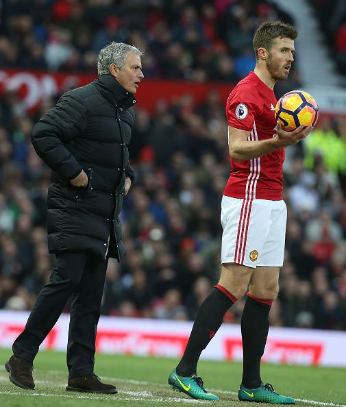 Manager Jose Mourinho of Manchester United speaks to Michael Carrick during the Premier League match between Manchester United and Sunderland at Old...