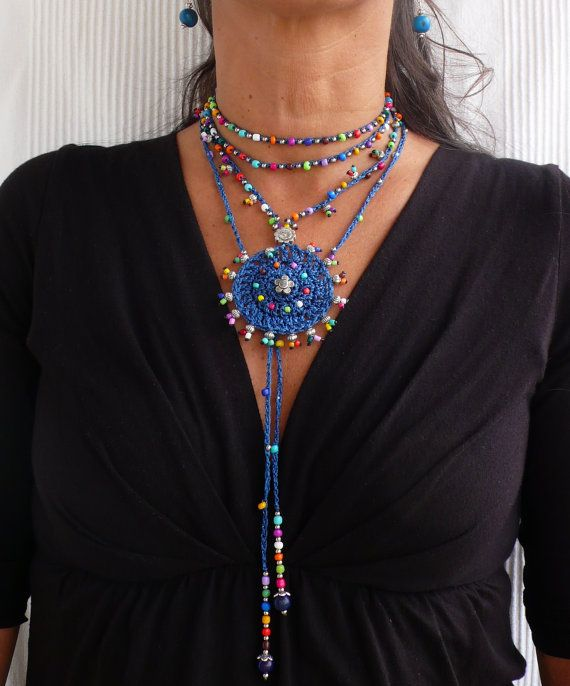 This beautiful necklace was crocheted with indigo blue waxed cord, glass beads and tibetan silver beads. It can be worn close to the neck or more loose, you just tight it however you like it. The lace is long enough to wrap it 2 times around the neck. Each end of the string is closed by with a few glass beads, an ornate silver bead cap and an acai seed bead. It´s one of a kind and will look great in summer or in winter. This crochet necklace is made to order and can me made in different…