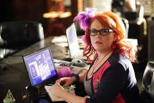 Penelope Garcia, Criminal Minds Played by Kirsten Vangsness, the technical analyst of the Behavioral Analysis Unit, not only breaks barriers with her coding expertise, but with her eccentric fashion skills as well. Garcia is never seen without her colorful and spunky glasses, huge hair accessories, and bright floral dresses.