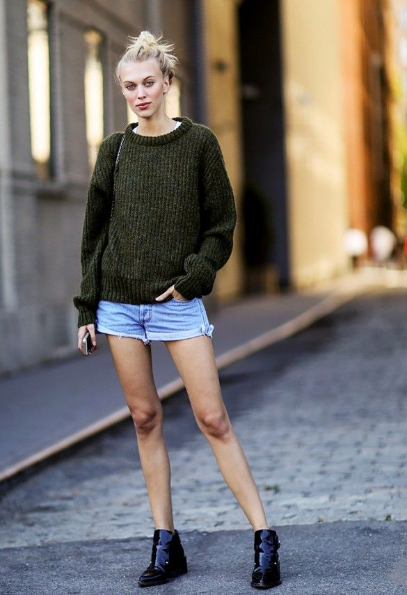 This is what fall dressing looks like in LA: chunky sweater balanced with denim cut-off shorts and black ankle boots.