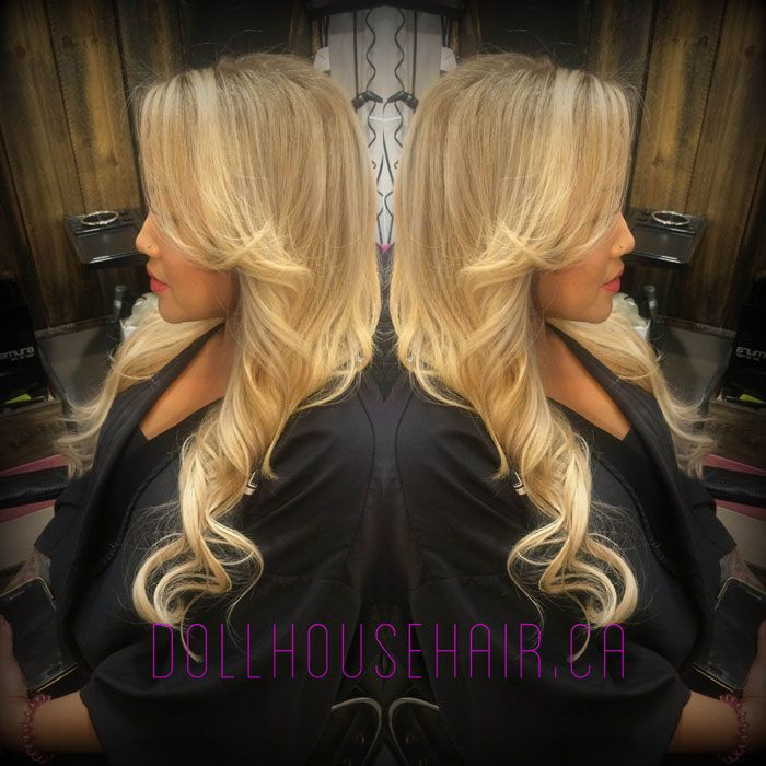 Greatlenghts hair extensions.  Beautiful curls done with a mint curling iron