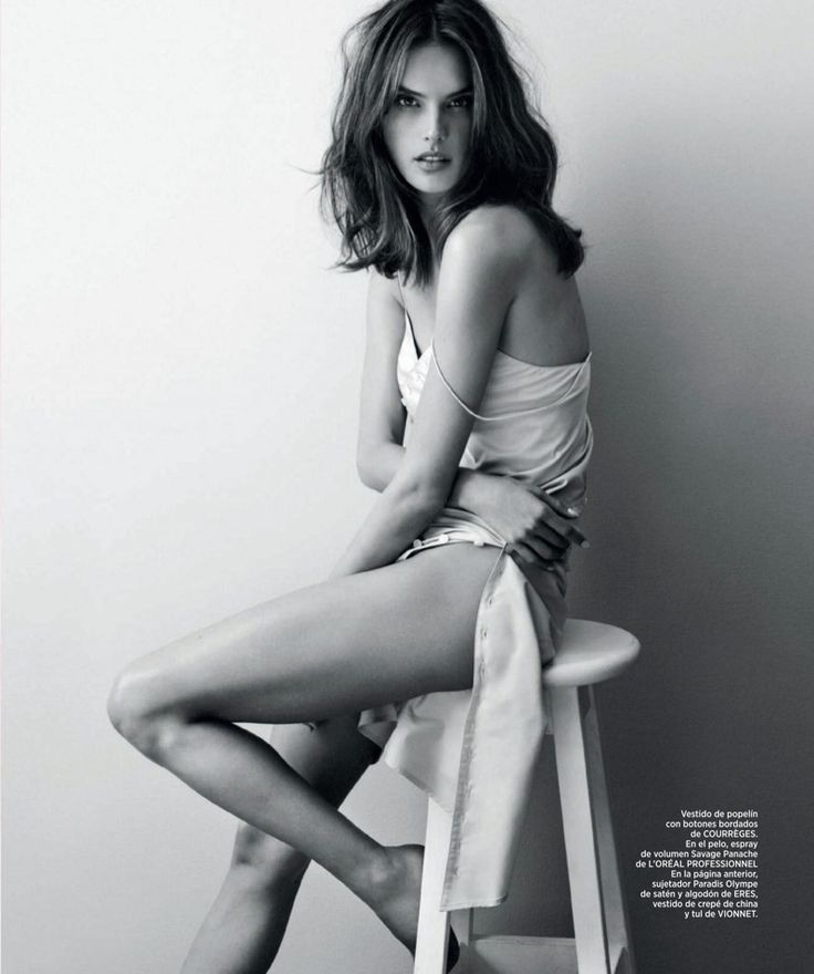 Sitting on a stool, Alessandra models a poplin slip dress from Courreges for Harper's Bazaar Spain Magazine May 2016 issue