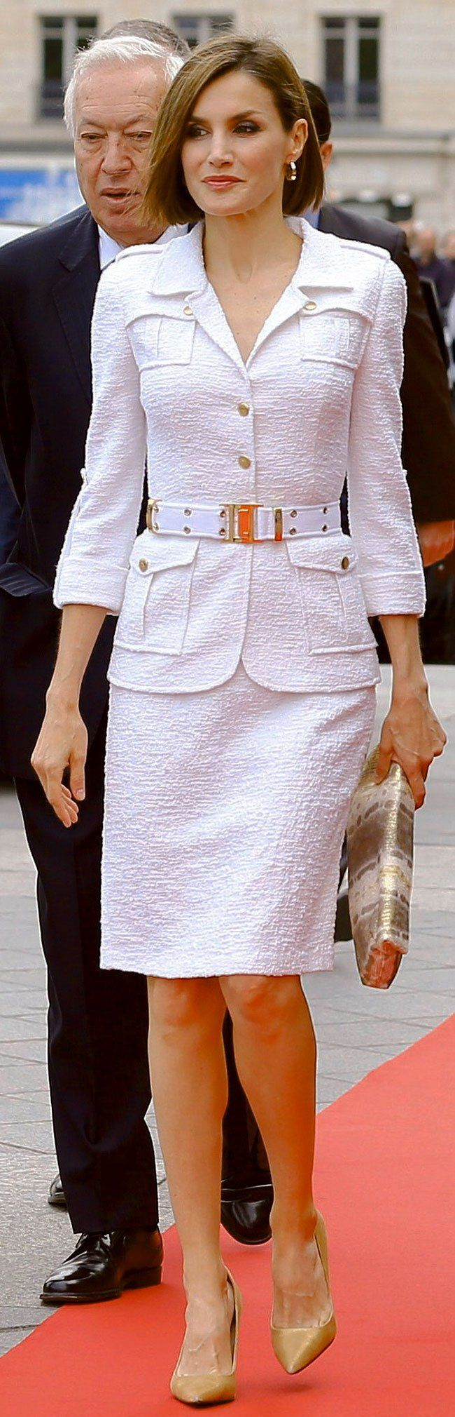 Queen Letizia of Spain attends a ceremony at Hotel de Ville on 03 June 2015 in Paris France.  For the occasion Doña Letizia wore an elegant, crisp white, Saharan-inspired bouclé skirt suit from Spanish designer Felipe Varela. Doña Letizia cinched the jacket with a matching canvas web belt, also from Varela.