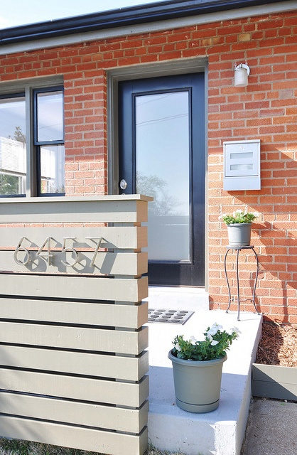 Mid century brick house entry, address (home depot), mailbox (chiasso), glass door (ordered custom in black from Lowe's)