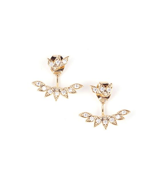 Stunning gold leaf design earrings featuring cubic zirconia CZ crystals with a leaf crystal ear jacket. -Approx 0.5 drop -Ear jacket -Brass Follow us on