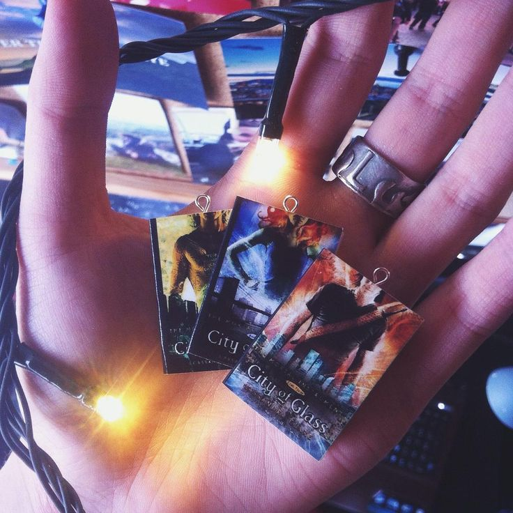Mortal Instruments mini book items. Earrings, necklace or keychain to make sure you always have your favourite book with you
