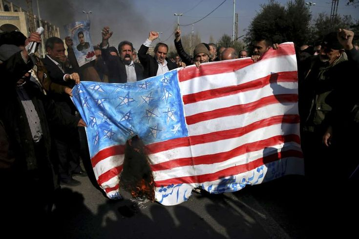 Iran's top diplomat: UN meeting on protests a US 'blunder'  - January 6, 2018.  Iranian worshippers chant slogans while they burn a representation of U.S. flag during a rally against anti-government protestors after the Friday prayer ceremony in Tehran, Iran, Jan. 5, 2018. A hard-line Iranian cleric has called on Iran to create its own indigenous social media apps, blaming them for the unrest that followed days of protest in the Islamic Republic over its economy. (AP Photo/Ebrahim Noroozi)