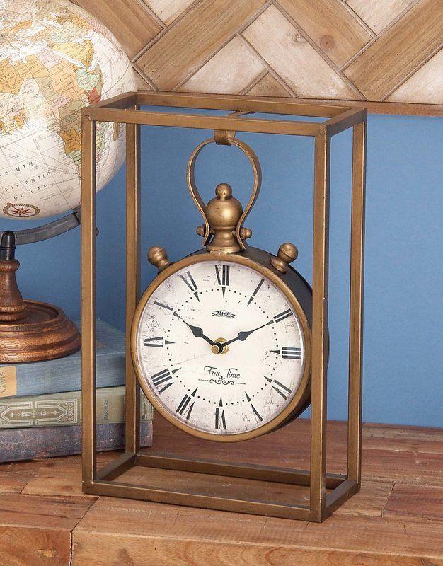 Werfen Sie einen Blick auf diese gut gestaltete Tischuhr aus Metall, die sicherlich die Einrichtung Ihres Zuhauses bereichern wird. Sie ist aus Metall gefertigt, was sie besonders haltbar macht und sie für die kommenden Jahre in tadellosem Zustand bleiben lässt. Sie ist ebenfalls einfach zu reinigen und zu pflegen. Ihr rundes Ziffernblatt ist auf einem glatten Holzrahmen angebracht und verleiht dieser Uhr ein erstaunliches Aussehen. Das Ziffernblatt ist weiß, während die römischen Zahlen…