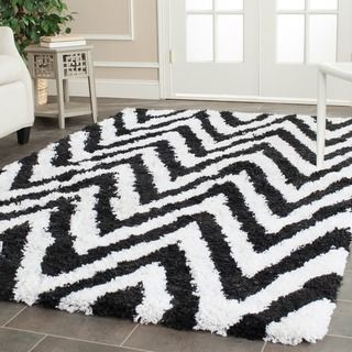 @Overstock - Safavieh Hand-made Chevron Ivory/ Black Shag Rug (6' x 9') - Safavieh's hand-tufted acrylic Chevron shags offer luxurious comfort in a trendy lifestyle rug. Inspired by today's hottest Chevron patterns and using today's freshest colors  http://www.overstock.com/Home-Garden/Safavieh-Hand-made-Chevron-Ivory-Black-Shag-Rug-6-x-9/7847732/product.html?CID=214117 $234.89