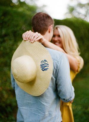 Southern Bride Engagement Picture- Big Sunhat with new monogram. Cutest idea.