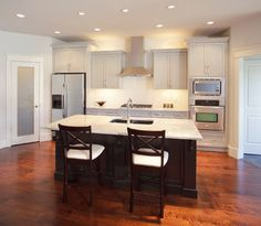 This is the layout I want...  Straight line kitchen with island (sink and dishwasher in island) range hood, fridge on left