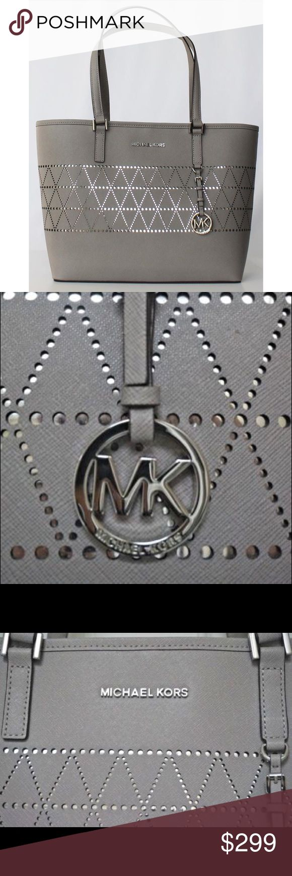 "Michael Kors Leather Tote Handbag Pearl Grey Size : Medium Color : Gray Features : Stain-Resistant, Clasp, Key Clip, Open, Handbag Pattern : Geometric, Diamond Bag Height : 10.5"" Strap Drop : 11in. Material : Leather Bag Length : Top15"" - Bottom 12.5"" Bag Depth : 4.5"" Michael Kors Bags"