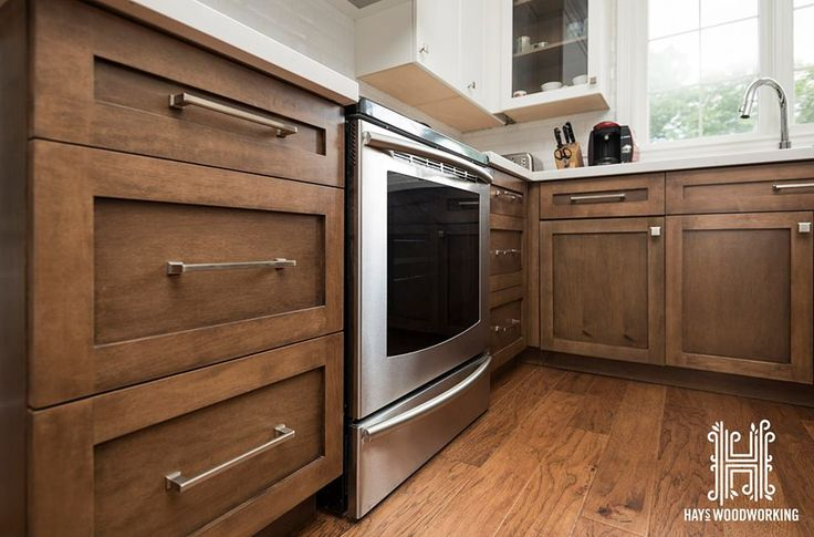 Fronts are shaker style the cabinetry is maple with the base cabinets