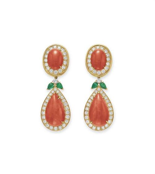 A PAIR OF CORAL, DIAMOND AND EMERALD EAR PENDANTS, BY DAVID WEBB Each suspending a detachable pear-shaped cabochon coral pendant within a circular-cut diamond surround, joined by cabochon emeralds, to the oval-shaped cabochon coral surmount of similar design, mounted in 18k gold Signed Webb for David Webb . Price $30.000. Christie's