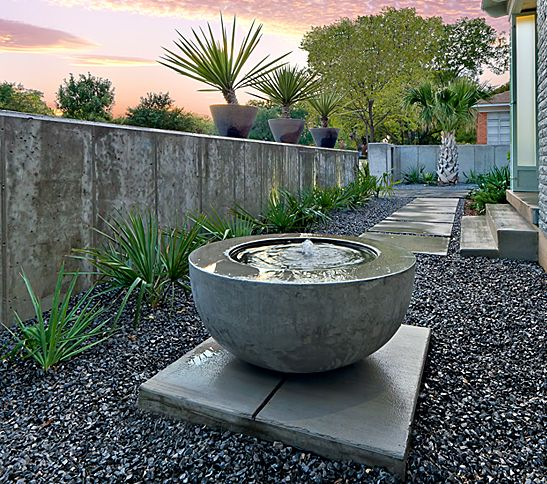 Simple Contemporary Water Bowl Set On Pavers