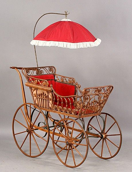 Antique Victorian wicker pram/carriage with attached parasol and velvet upholstered interior circa 1890.