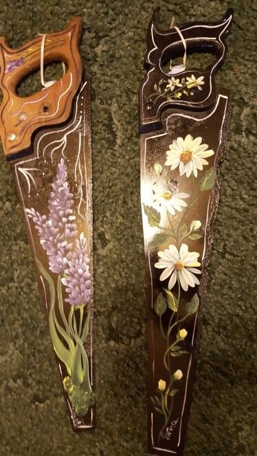 Hand painted saws by Diana Roller