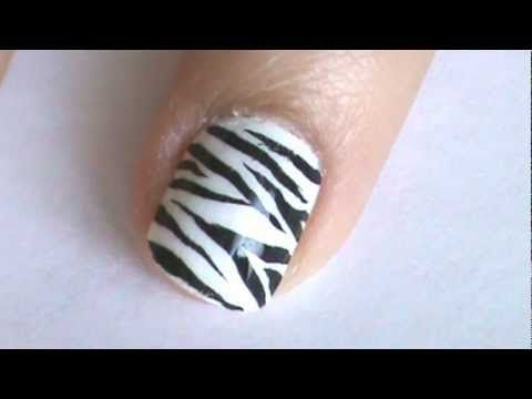 Here is a zebra nail art design! Thanks for watching and hope you try out this nail art design! Subscribe for more nail art videos http://www.youtube.com/simplenailartdesigns    Music by Dan-O at DanoSongs.com    zebra nails nail art design print animal easy cute stripes polish tutorial how to zebra nails nail art design print animal easy cute strip...