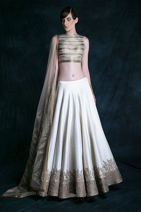 A new definition to the Shantanu & Nikhil cocktail Lehenga with graphic textures in gold radiates the new identity for this otherwise beautifully traditional silhouette #ShantanuNikhil #SpringSummer15 #Top5BridalTrends
