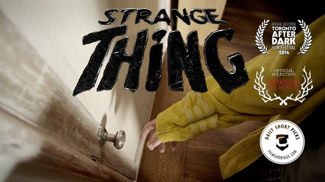 "A newly married couple, Kris and Jake, wake up to find a door has appeared in their living room. As the temptation to open the door lingers the couple discusses how to handle this bizarre phenomenon as they discover more about the person they each married.   ""Strange Thing"" is a sci-fi thriller made in the tradition of 1980's sci-fi films featuring a strong score and stunning practical and visual effects. Aspects of the film are inspired by a classic episode of Star Trek: TNG, guess which…"
