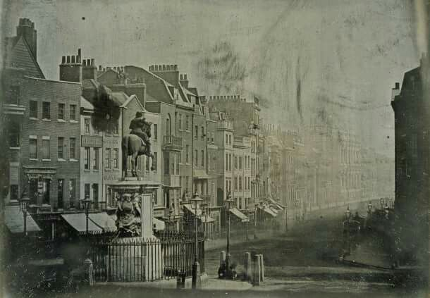 ..OLDEST PHOTOGRAPH.   This daguerreotype photo, looking south down Whitehall from Trafalgar Square, was taken in 1839, and is thought to be the oldest photo of London. The hustle and bustle of carriage and pedestrian traffic has been blurred by the several minute long exposure...