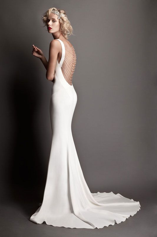 Robert Cavalli 2015 - back view - dramatic deep bare back with rows of beading swaged across the opening.  White silk crepe; bias cut hugs every curve.  Gown has a lovely chapel train.