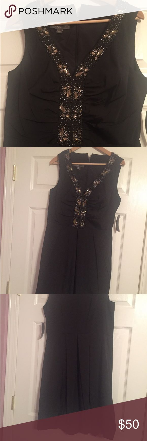 NWT Donna Ricco Black Dress Size 14 New Donna Ricco Black fit and flare dress with full/bubble skirt, beaded design and v-neck. Size 14, from a non-smoking home. Donna Ricco Dresses Wedding