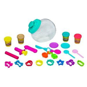 """Candy Jar by Play-Doh. $10.99. Set includes 2 lollipop sticks, scoop/cup half-mold, 8 cutters, 2 dishes, 3 half-molds, plastic knife, roller, presser and 4 two-ounce cans of Play-Doh modeling compound.. 19 """"candy"""" accessories!. 4 cans of Play-Doh modeling compound!. 8 cutters and 4 half-molds!. Make Play-Doh sweet treats!. From the Manufacturer                Create all the pretend sweet treats you can imagine with the Candy Jar Set! With the tools in this set..."""