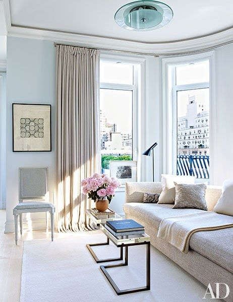 A simple yet luxe sitting area with plenty of natural light | archdigest.com