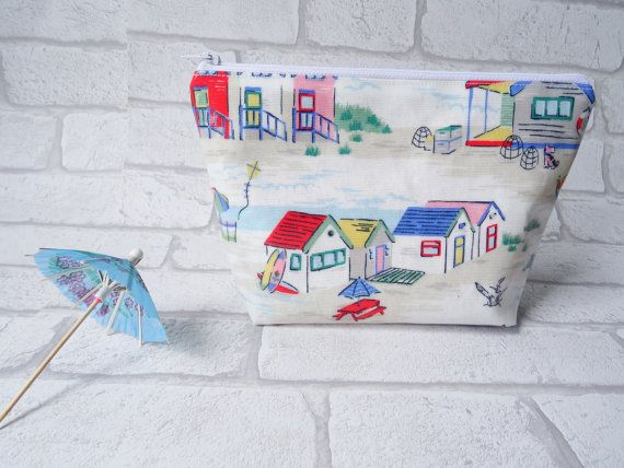 Transport yourself away to somewhere warm and sunny with this lovely retro Cath Kidston beach hut makeup bag. It would make a great travel wash bag