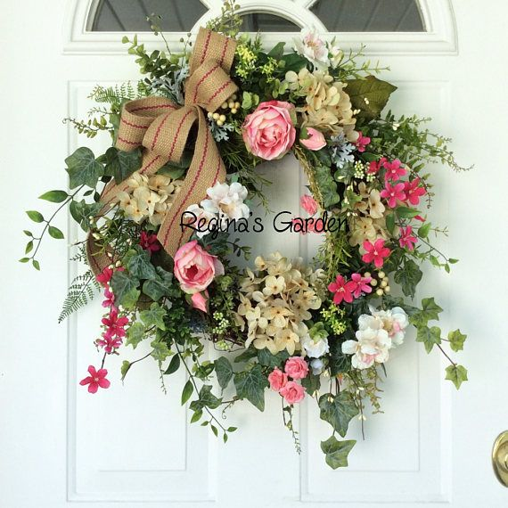 Summer Door Wreath-Hydrangea Wreath-French Country Wreath-Wedding Flowers-Farmhouse Decor-Cottage Chic Wreath-Designer Wreath This sweet wreath is designed with lovely shades of blush pink roses, variegated pink apple blossoms, cream hydrangea and bright pink flowering vines. A mix of realistic garden foliage, including ferns, trailing ivy, seeded eucalyptus and dusty miller is sprinkled with clusters of tiny cream pip berries. The wreath is finished with a jute ribbon with a double pink…