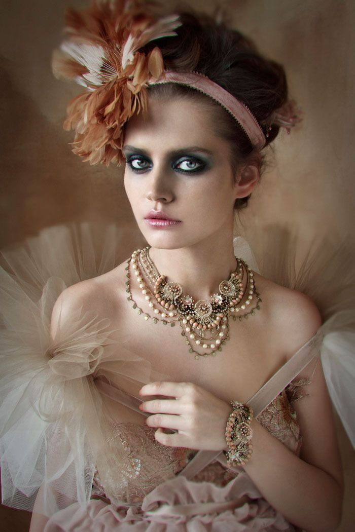 The outfit makes her look historical, but the hair and makeup is styled in such a way that it wouldn't be uncommon to see on models today.