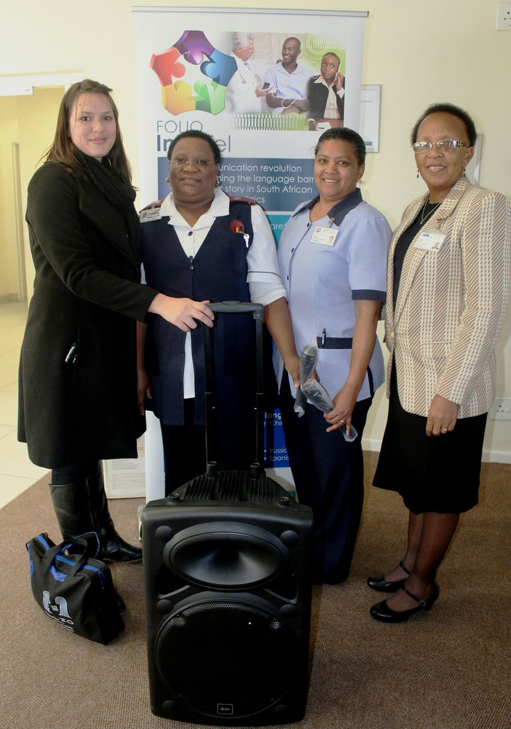 Staff members of Mitchells Plain CHC with their prize, a portable PA system with cordless microphones, presented to them by Folio InterTel's Lauri King.