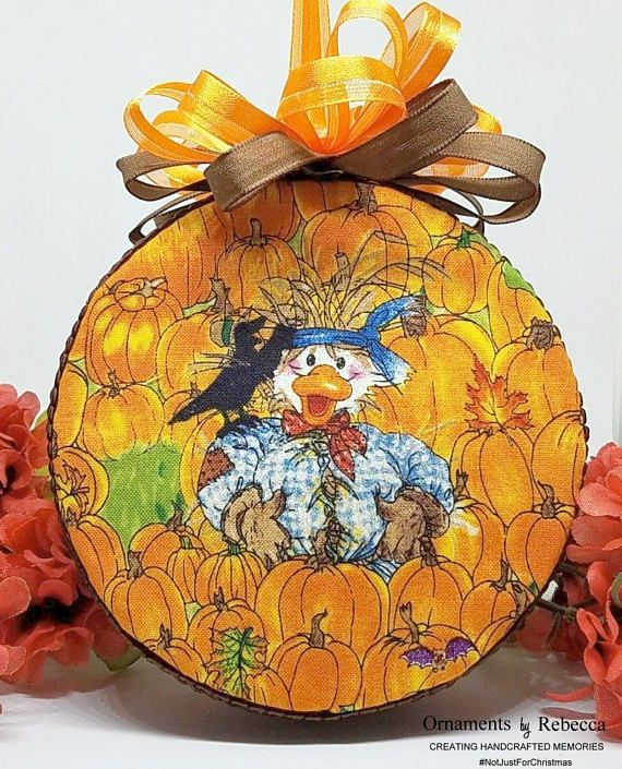 Denny McDuck is having fun in the pumpkin patch as the temps cool down and it looks like he has found the perfect scarecrow costume! This handmade quilted keepsake half ball ornament measures 4 in diameter and is made with a golden caramels, browns and orange colors that brighten our autumn days. It is topped with a dual brown and orange bow. Perfect for those that love the deep rich colors of fall/autumn. Makes a great gift. Hang from a ornament stand or pile several in a basket. Ready ...
