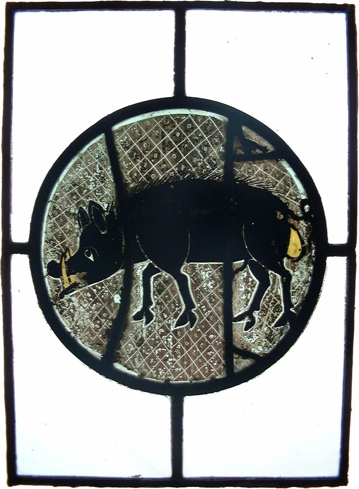 14th Century stained glass - boars!