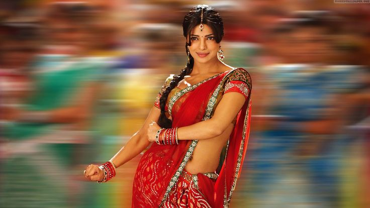 A Splashing Red that immediately attracts everybody!! Please somebody gift me this half saree!!