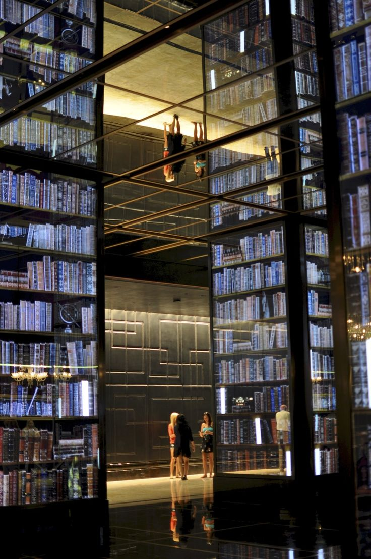 """the """"bookshelves"""" are 3d flat screens with multiple layers that change pictures."""
