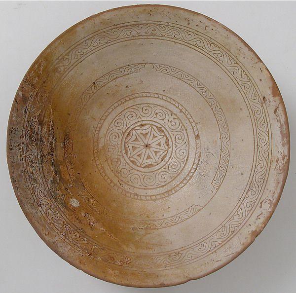 Bowl with Geometric Rosette Date: 1100–1150 Culture: Byzantine Medium: Engraved slip ware:orange clay, cream slip, transparent yellowish glaze Dimensions: Overall: 2 15/16 x 7 7/8 in. (7.5 x 20 cm) diam. of foot: 3 7/16 in. (8.8 cm)