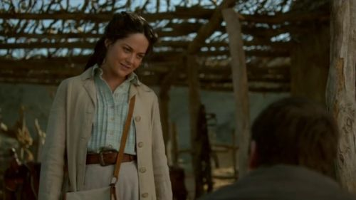 Penny Dreadful S03E03 (Good and Evil Braided Be) - Sarah Greene as Hecate Poole wearing a long front-buttoned canvas coat over a checked shirt and long skirt. The accessories include a canvas bag with leather trims leather belt and gloves.  The costumes were designed by Gabriella Pescucci.