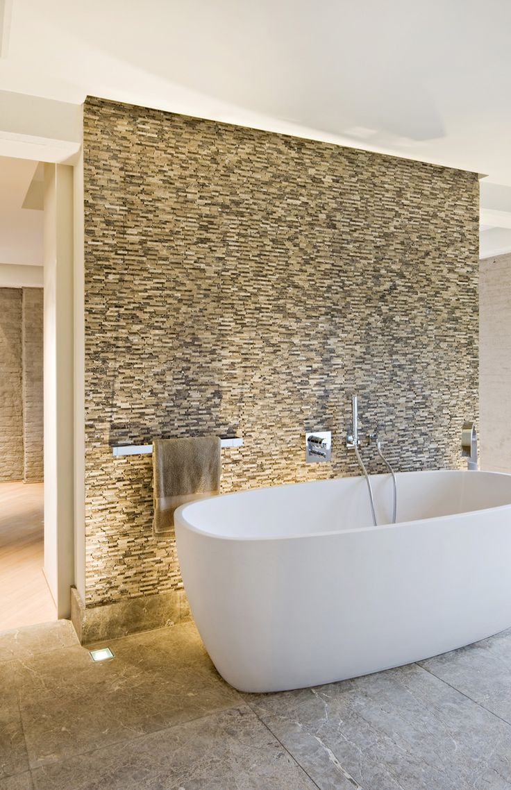 Great feature wall behind the bath tub, complete with up-lighting. Like the combo of large floor tiles & smaller mosaics.