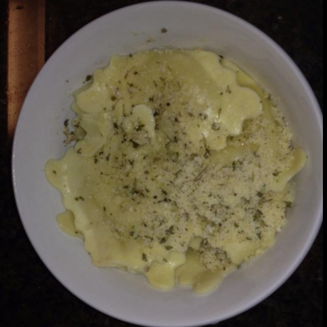 Chicken Sausage Ravioli Topped w/ Parmesan & Herb