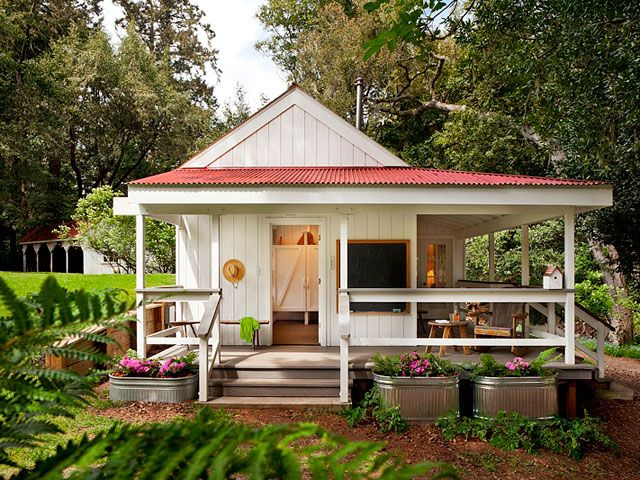 Richardson Architects 260-Square-Foot House -The front AND side porches really add to the living area--it isn't obvious at first glance just how tiny the cottage itself is. Also, LOVE the plants in the galvanized troughs