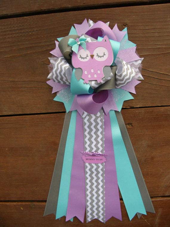 shower! Size is approx.6.wide 15long. Lots of ribbons make this corsage full of ribbon.can be placed on the new mothers hospital room door and then later
