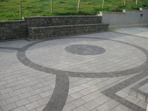 Johnston Paving Contractor : circular patterns within a patio area that also incorporates raised planters : Driveway & Patio Paving Contractors in Fermanagh