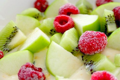 Granny Smith Apple Slices, Kiwi Slices, and a handful of frozen Raspberries, mixed in with Vanilla Yogurt.