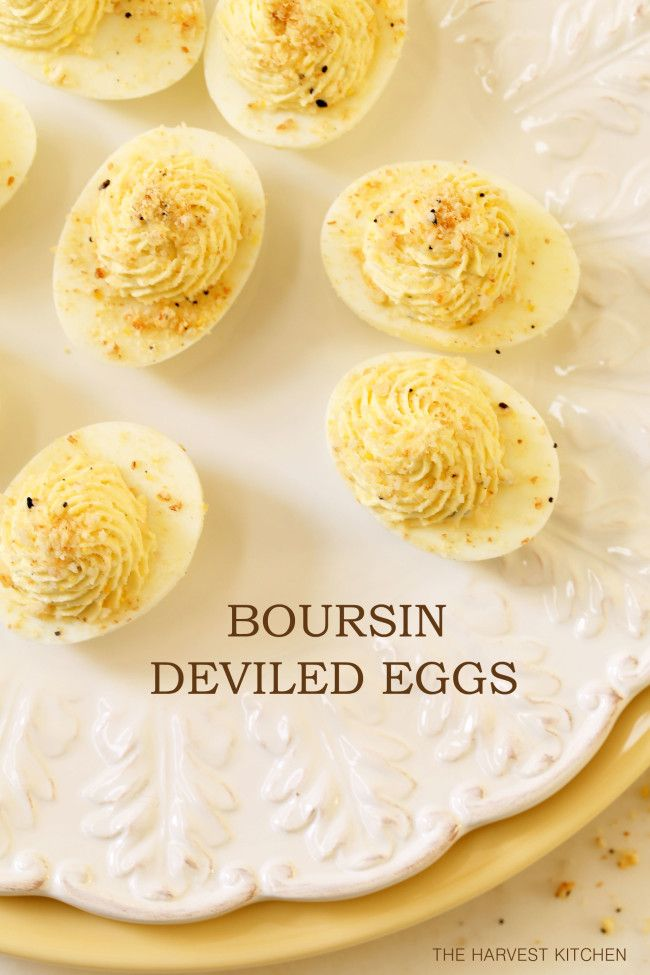 from The Harvest Kitchen / Boursin Deviled Eggs - these eggs are made with Boursin Cheese and dusted with your favorite cracker for a cheese and cracker deviled egg all in one. Completely addicting! @theharvestkitchen.com