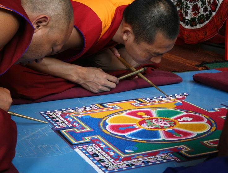 Sand Mandala By David Stephensen. The monks spend several days creating these beautiful works of art using coloured sand. When they have finished, with a prayer, they sweep it up and throw it into a body of water. This teaches us about the impermanence of all things. We are honoured to have such a presence of Tibetan Buddhists in Bendigo, with our local Atisha Centre and frequent visitors wearing maroon robes. Last year the Dalai Lama came to Bendigo to bless the Great Stupa that is being…